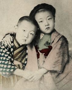 Portrait of two young siblings. Hand-colored photo, about 1900, Japan.  Unknown photographer