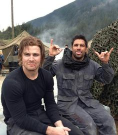 Stephen Amell and Manu Bennett fooling around on the Arrow set