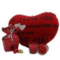 Sweet Love Combo Celebrate the occasion with this red hot valentine special combo. A I love you cushion of 13.5 Into 10.5 inches, 2.5 inches candles along with 6 Into 4 Into2 inches red paper bag full of chocolates for your loved ones. Shipping Status - GiftsXpert.in - Product deliver by Courier in 4 to 7 day