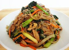 Japchae - Korean stir fried noodles and vegetables via maangchi - my number one source for Korean recipes. - Looks good but I'd have to replace the mushrooms for Clark to eat it. Kimchi, Korean Dishes, Korean Food, Asian Recipes, Healthy Recipes, Ethnic Recipes, Stir Fry Glass Noodles, Korean Noodles, Sweet Potato Noodles