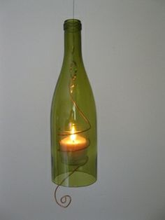 At last I  have some samples of the hanging wine bottle candles I make. Pictured is the light green amber glass candle. There are several styles. Candles come with a copper wrapped wire votive and hang by a cable. The can hang outside as well. They sell for $20.00 and I can ship. See serendipitini.com for different styles and colors.