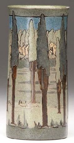 A Saturday Evening Girls  [Paul Revere Pottery] exceptional cylindrical vase decorated in cuerda seca with a village seen through tall trees. Arts and crafts pottery; Craftsman bungalow