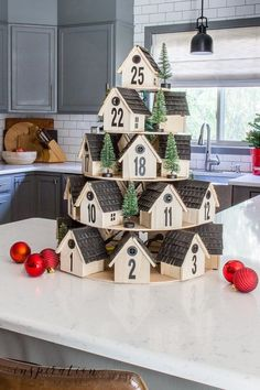 Countdown to Christmas with this festive wooden houses Advent calendar. I give you all the steps to easily create one for your own home! | Who doesn't love a good countdown to Christmas? So when the Home Depot reached out and ask if I'd like to create an Advent calendar – I jumped at the chance. And after some thought, a little design planning and some trial and error, I came up with a super cute tiered wooden houses Advent calendar. #HomeDepot #AdventCalendar #ChristmasCountdown Wooden House Advent Calendar, Advent House, Diy Advent Calendar, Kids Calendar, Advent Calendars, Mini Christmas Tree, All Things Christmas, Christmas Crafts, Christmas Decorations
