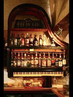 Turn an old piano into a shelf! Love it!