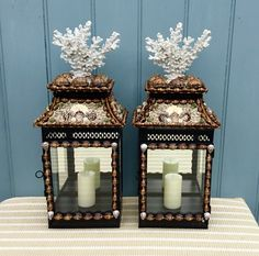 Shelled candle lanterns with faux coral