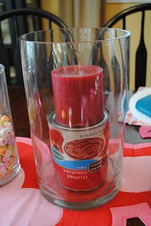 Easy Valentine's Day Centerpiece. Put can under candle.  Keeps candle level. Use less decorative filler!!