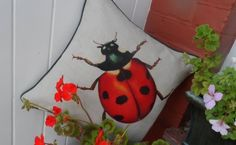 Ladybird print cushion. Linen mix insect pillow. £28.50