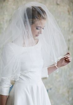 """Ruche: Classic Romance Ivory Veil 56.99 at shopruche.com. Simple and elegant, this ivory tulle elbow veil is finished with cream satin ribbon, a blusher, and a raw edge for added texture.  29"""" long, 3"""" clear comb"""