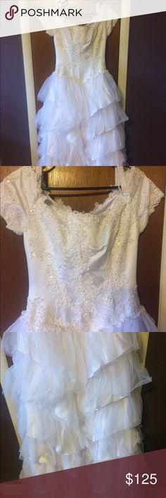 Short sleeve beaded wedding dress Short sleeve wedding dress. Beaded bodice. Lots of ruffles of skirt. Dresses Wedding