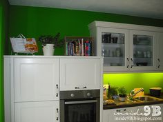 Our Nobilia kitchen (Lucca). We use an old wine crate to store our cook books. kitchen green white