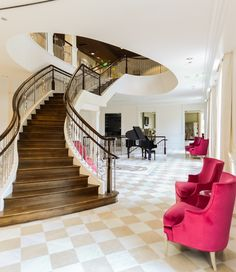 Elegant double open curved staircase at the University of Alabama.