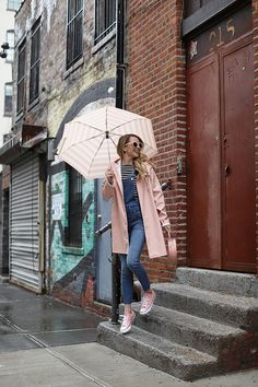 A pink rain jacket and striped umbrella // A rainy day outfit on Atlantic-Pacific Atlantic Pacific, Rainy Outfit, Outfit Of The Day, Rainy Day Outfit For Spring, Outfit Winter, Simple Outfits, Casual Outfits, Cute Outfits, Look Fashion