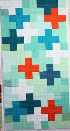 cute quilt. love the colors + nontraditional design.