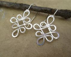 New in our shop! Looping Celtic Crossed Knots Sterling Silver by nicholasandfelice, $26.00