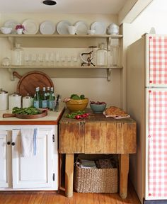 A gingham paper tablecloth from West Elm, affixed with magnets, peps up a plain fridge.
