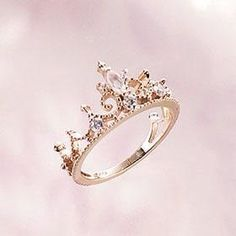 No gold but the crown means that one day I will be your queen & you my king... promise ring.