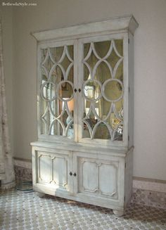 Mirrored cabinet.