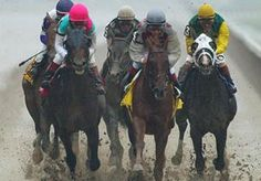 Image: Funny Cide, second from right, leads the field at the 2003 Belmont Stakes (© Ed Betz/AP)