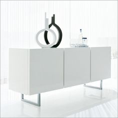 Shop AllModern for stylish sideboards and buffets. Store your extra table linens, dinnerware, and flatware in a modern kitchen buffet and expand your storage options! White Buffet, White Sideboard, Modern Furniture Stores, Home Furniture Online, Dining Room Buffet, Dining Decor, Buffet Hutch, Sideboard Furniture, Living Room Furniture