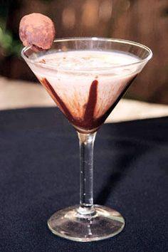 Chocolate Martini  3/4 oz. Godiva White and Dark liquor 1 1/4 oz. Van Gogh Chocolate Vodka 3/4 oz. Tia Maria 3/4 oz. Kahlua 3/4 oz. Frangelico 3/4 oz. Half and Half Hint of chocolate syrup Garnished with dark chocolate truffle