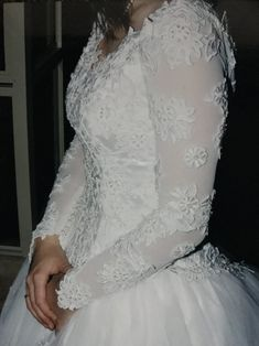 The traditional wedding dress with sleeves and lace appliques
