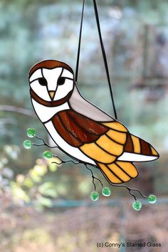A stunning Stained Glass Barn Owl stained glass suncatcher for your home. This beautifully handcrafted suncatcher measures approximately 12 X 6. With this piece, I have combined my two passions, stained glass and wildlife photography. I am very particular about the glass choices I