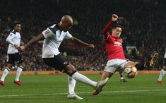 Ander Herrera of Manchester United in action with Andre Wisdom of Derby County during the Emirates FA Cup Third Round match between Manchester United...