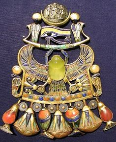 "Jewelry from Ancient Egypt. The yellow stone in the center of the scarab is the infamous ""Desert Glass"" of Egypt, fused silica gathered from the site of a meteoric impact in the desert. It was considered a precious stone and is easy to spot in Egyptian royal jewelry by its clarity and its distinctive lemon yellow color."