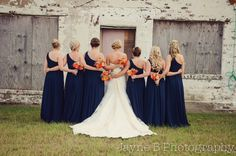 orange and blue wedding bouquets @Nicole Novembrino Novembrino Novembrino Novembrino Novembrino Novembrino Novembrino I know you want sunflowers but this looks cool too