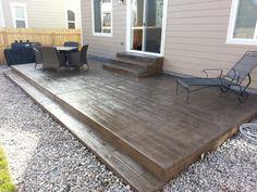 Wood-grain texture stamped concrete patio & steps