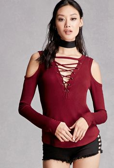 A ribbed knit top featuring an open shoulder, long sleeves, a square neckline with a V-shape cutout and a strappy design, burnished grommets, and a curved hem. This is an independent brand and not a Forever 21 branded item.