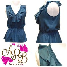 Perfect Sapphire Ruffled Top. Find it here: http://androbel.com/tops/day-2-night-blouses/sapphire-ruffle-front-blouse.html