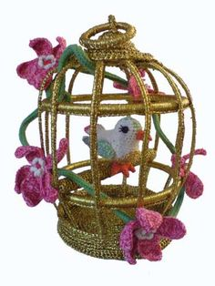 Chinese nightingale in golden cage...