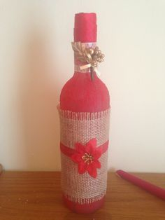 Red paint+glitter, hessian, ribbon and decorations