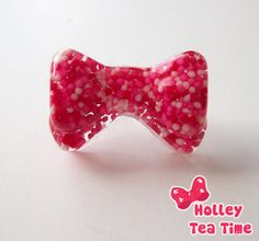 """☆ made from resin, glitter and paint  ☆ made with real sprinkles  ☆ red, white and pink sprinkles  ☆ glued on silver plated adjustable ring  ☆ ring: metal with nickle free plating  ☆ bow size: 3.7 cm x 2.5 cm (1.4"""" x 0.98"""")  ☆ handmade product  Part of the ♥ Sweet Love ❤ collection ♥  ht..."""