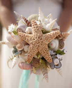 Why not have a bouquet made out of seashells.  ~~OUCH... don't throw this~~
