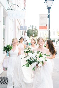 Bride and Bridesmaids walking down King St in Charleston SC.  Coordination | Mac & B Events >> Photography | Aaron and Jillian Photography >> Florist | Tiger Lily Florist