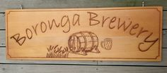 Western red cedar sign 800 x 250 mm. Laser engraved images and text. Stainless steel eye bolt hanging. MyChoice@Firebridge