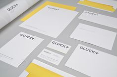 The identity applied to stationery. The program appears in a modern palette of dark grey and bright yellow.