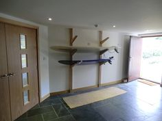 Surf Board Rack... would also store wakeboards and snowboards with the surf boards