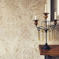Walls painted with stencil to mimic Fortuny damask fabric