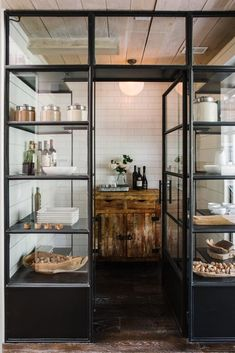 Rustic industrial kitchen pantry with steel doors.
