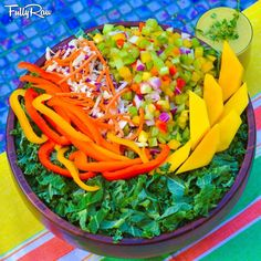 EAT TO LIVE! Tonight's FullyRaw Rainbow Feast: bed of local greens topped with mango, bell peppers, shredded purple/green cabbage, carrots, celery, and green onions with an orange juice mango mint dressing!