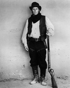 A gallery of Young Guns publicity stills and other photos. Featuring Emilio Estevez, Kiefer Sutherland, Lou Diamond Phillips, Charlie Sheen and others. John Fusco, Classic Country Artists, Emilio Estevez, Brat Pack, Billy The Kids, Young Guns, Story Characters, Fictional Characters, The Best Films