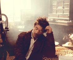 """Holmes (Robert Downey Jr.) is utterly bored.  (""""Sherlock Holmes,"""" 2009)"""