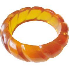 Bakelite Bangle Bracelet Vintage 1930s Prystal Apple Juice Rope Carved Estate Jewelry Was $450 - Now $265  https://www.rubylane.com/item/676693-JL271/Bakelite-Bangle-Bracelet-Vintage-1930s-Prystal