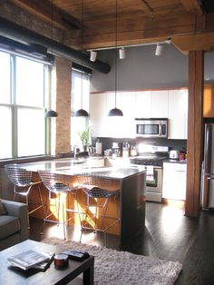 This #Bucktown loft for rent has a spiral staircase leading to a rooftop deck, 14-foot ceilings, and a custom-built fireplace. #chicago #apartments #loft