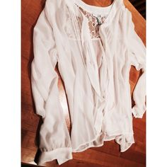 Forever 21 Sheer Long Sleeve Shirt New with tags long sleeve sheer shirt.  Has knot/floral design on top of shoulders in the back.  Ties in the front and buttons down Forever 21 Tops Blouses