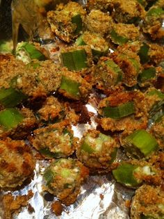 Oven Fried Okra, (used 3/4 cup of flax meal, 1/4 cup unsweetened coconut flakes, 1/4 cup almond meal instead of breadcrumbs. used chicken broth instead of buttermilk. in a glass dish with coconut oil. added cayenne pepper. also cooked some sliced squash with it) The kids kept wanting more.