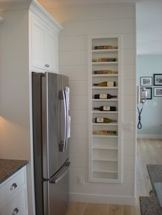 A creative way to store your wine is to make use of the space between the studs in your wall. But make sure your rack is built with a lip to keep the wine from rolling off the edge.
